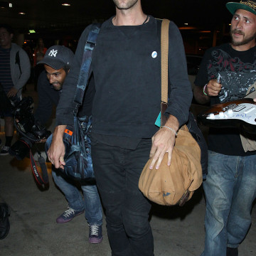Coldplay Frontman Chris Martin Arrives at LAX Airport